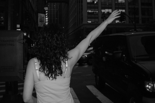 Amanda, hailing a cab in New York