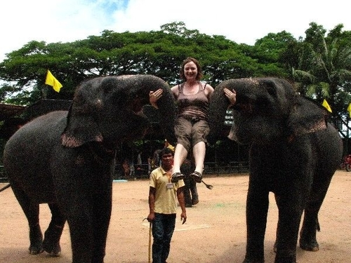 Karen being lifted by elephant trunks