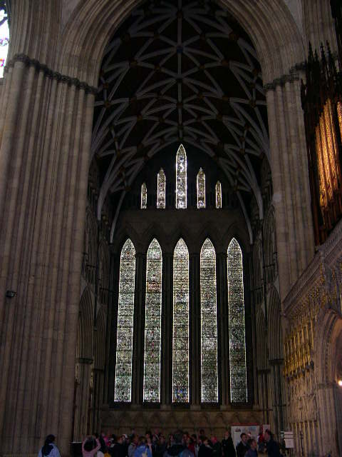 Yorkminster Abbey stained glass with tourists