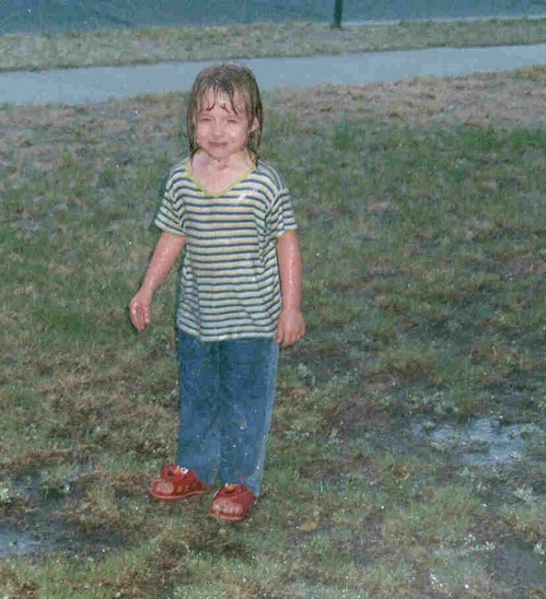 Raine in the sprinklers